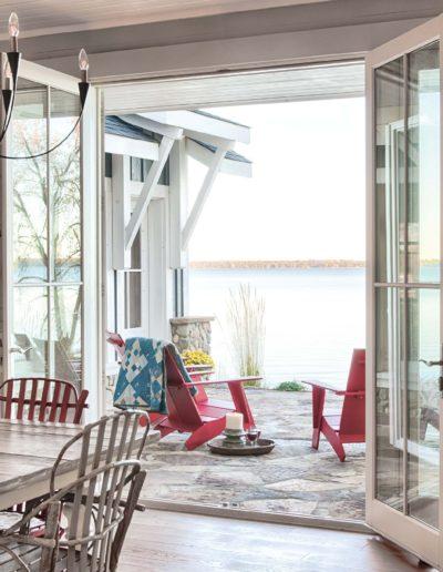 white exterior door leading to outdoor stone patio