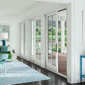 white custom doors leading to outdoor patio